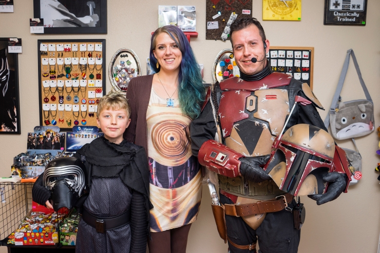 "From left to right, Charlie, Meredith and Uriah Funk stand in their new shop, Laser Moon Nerd H.Q. that opened on Aug. 5, 2016 in Loveland. Meredith began laser cutting her trinkets two years ago and has been selling her work on Etsy and Ebay and opened up a shop of her own to sell other art and ""nerd"" goods. Photo by Michael Ortiz/ Loveland Reporter-Herald"